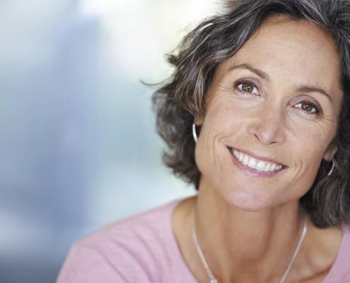 Closeup shot of a mature woman sitting indoors